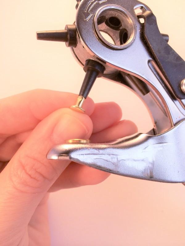 Rivet fitting inside hole punch tube