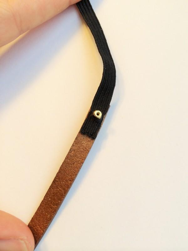 rivet set halfway through elastic and leather