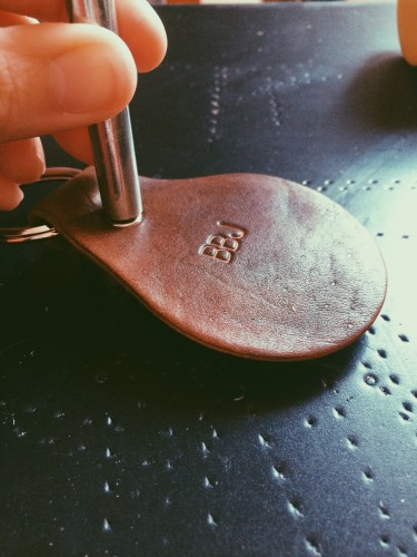 Riveting the leather key chain together