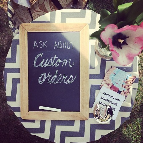 chevron table cloth with custom orders sign